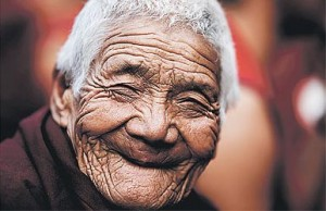 Smiling old woman long term travel image