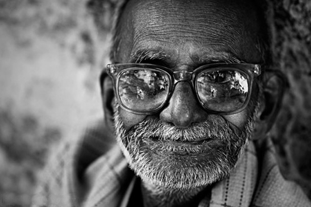 happy old indian man long term travel picture